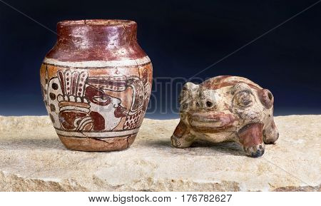 Mayan Pre Columbian warrior vase and turtle rattle made around 600-1000 AD.