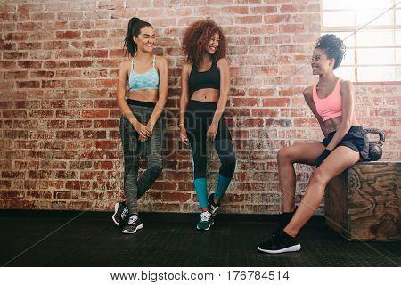 Three Mixed Race Women Relaxing In Gym