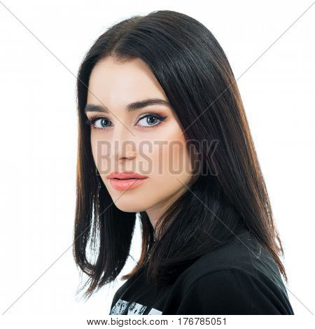 Beautiful brunette young woman lokking at camera over white background.