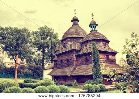 Wooden Holy Trinity Church in Zhovkva. UNESCO World Heritage. Vintage toned