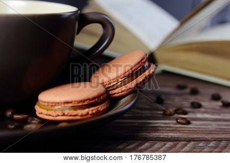 coffee cookies macaroon with a Cup of coffee and a book