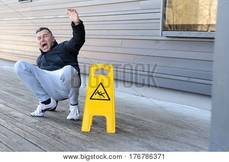 Middle-aged Man Yelling Out In Pain