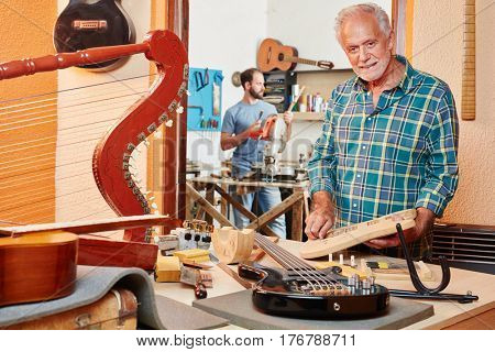 Senior citizen as luthier makes new guitar at his shop