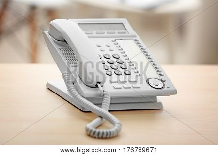 Telephone on wooden table in office