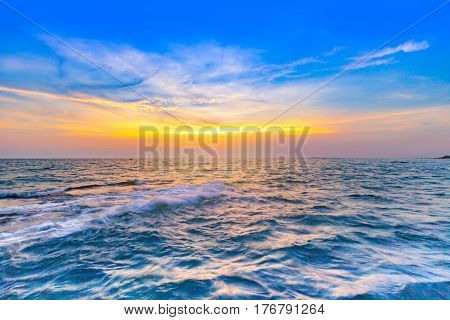 beautiful sunset at the sea with colorful shading of sunlight and sky