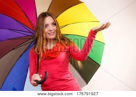 Woman Standing Under Multicolored Umbrella