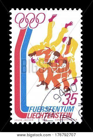 LIECHTENSTEIN - CIRCA 1976 : Cancelled postage stamp printed by Liechtenstein, that shows Wrestling.