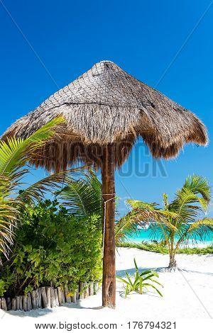 White Sand And Beach Umbrella
