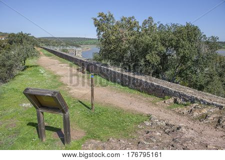 Overlooking at Dam of Cornalvo Reservoir from top of the wall. This dam was declared National Monument on Dec 13th 1912 and it is still in use nowadays. Extremadura Spain