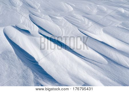 Whimsical beautiful shapes of weathered snow surface