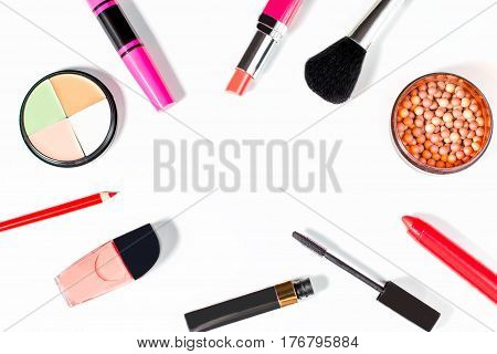 Collection of women make up accessories - concealer, blusher, mascara, lipstick, nail polish, on white background, flat lay, copyspace.