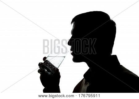 Young Man Drinks Soda Water - Silhouette
