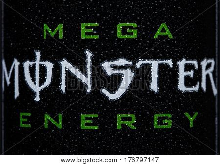 London, Uk - March 15, 2017:  A Can Close Up Logo Of Monster Energy Drink On Black. Introduced In 20