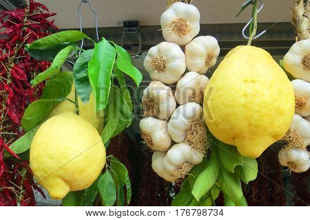 Lemons, Garlic, and Chilis Hanging at a Fruit and Vegetable Market