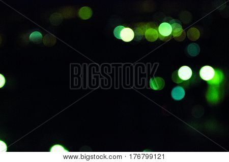 blur lights in black backround bokeh colours