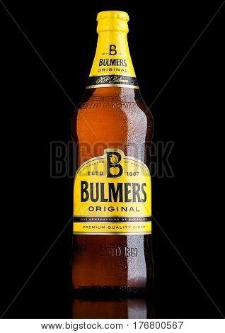 LONDON UK - MARCH 15 2017: Bottle Of Bulmers Original Cider on a black background with reflection. It is one of the leading British cider brands in the UK