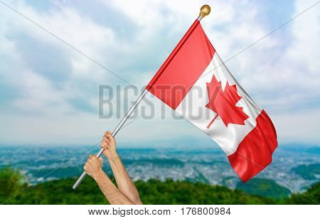 Young man's hands proudly waving the Canada national flag in the sky, part 3D rendering