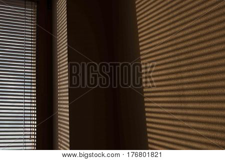 shade of venetian blind on the wall subject shadow on the wall shadow wallpaper shadow. Light falls on a subject and creates shadows on the wallpaper in the room.