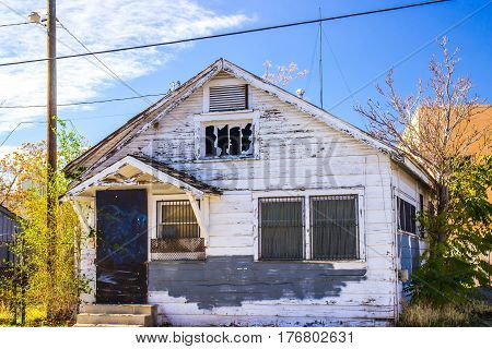 Abandoned Home With Broken Windows & Bars