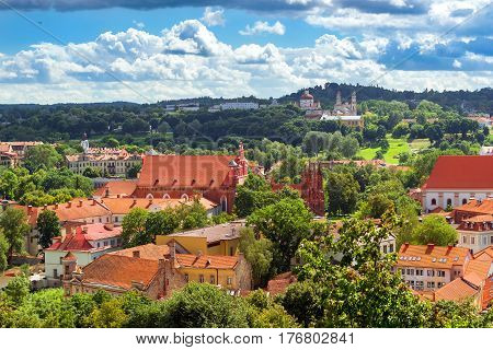 Gothic Church of St. Anne & St. Francis of Assisi (Bernardine) Roman Catholic Church. Vilnius from top of Gediminas Tower. Red rooftops of old town spires & towers of cathedrals & churches. Lithuania