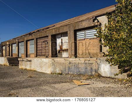 Abandoned Commercial Building With Loading Dock & Roll Up Doors