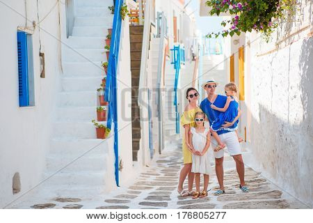 Family having fun outdoors on Mykonos streets