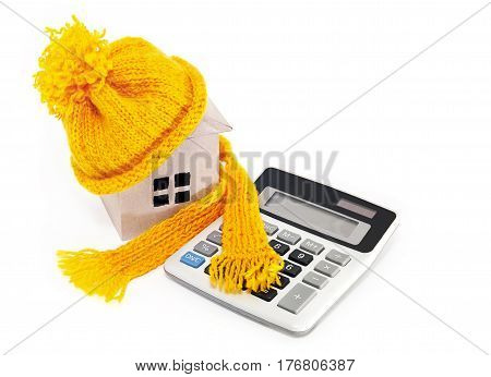 The costs of home insulation. House in a hat with a scarf and a calculator
