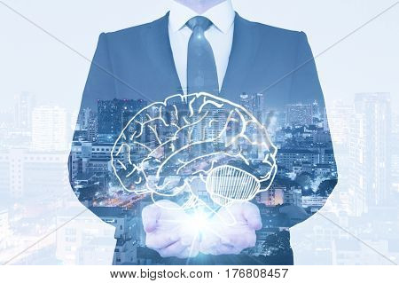 Businessman holding abstract brain on nigth city background. Brainstorming concept. Double exposure