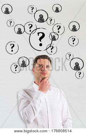 Thoughtful businessman on concrete background with drawn question marks and HR icons. Searching for talented employees concept
