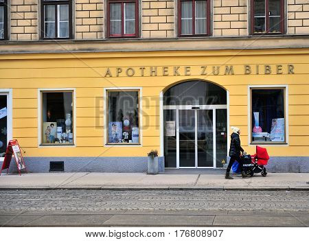 VIENNA AUSTRIA - FEBRUARY 11: Undefined person with a baby stroller in the street of Vienna on February 11 2017. Vienna is a capital and largest city of Austria.