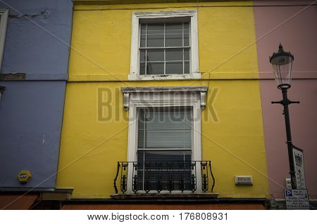 facade of a yellow house in notting hill