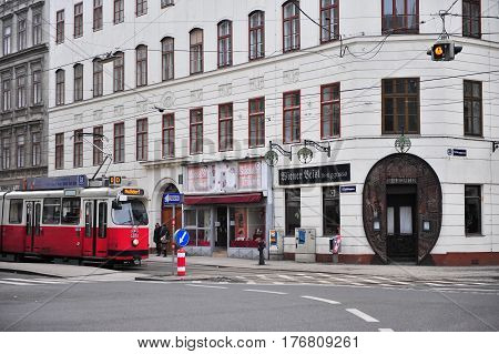 VIENNA AUSTRIA - FEBRUARY 11: Old fashioned tram goes by the street of Vienna on February 11 2017. Vienna is a capital and largest city of Austria.