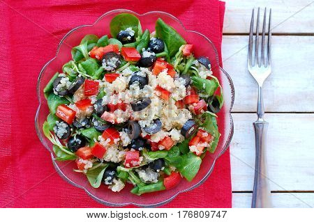 Fresh Healthy Vegan Salad With Quinoa, Corn Salad, Black Olives, Red Pepper And Olive Oil In Glass B