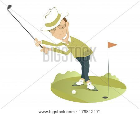 Smiling golfer on the golf course. Smiling golfer in the hat is trying to send the ball to the hole