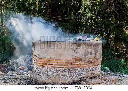 Open-air incinerator and refractory brick in nature background.