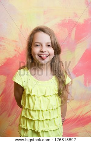 Small Baby Girl With Happy Face In Yellow Shirt