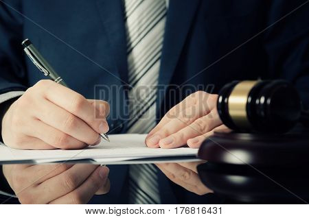Lawyer Working With Agreement In Office