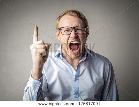 Shouting man pointing his finger