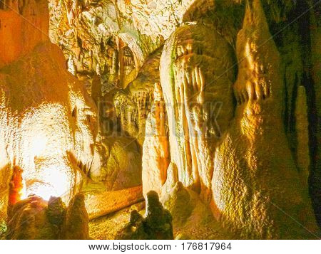 Picturesque karst features illuminated in the cave, Postojna grotte or Postojnska jama, Slovenia, Europe