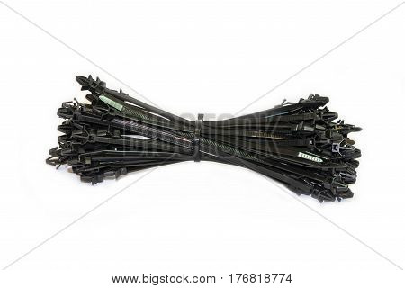 Bunch of black cable binder on white background isolated