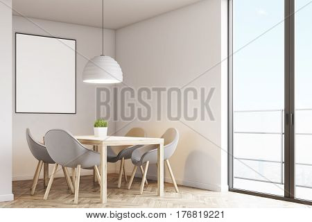 Corner of a kitchen with a table four gray chairs and a poster hanging on a light gray wall. 3d rendering mock up
