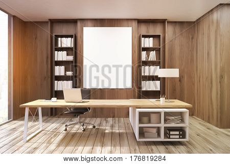 Front view of a CEO office with a large table a laptop two bookcases and a vertical poster on a dark wooden wall. 3d rendering. Mock up. Toned image.