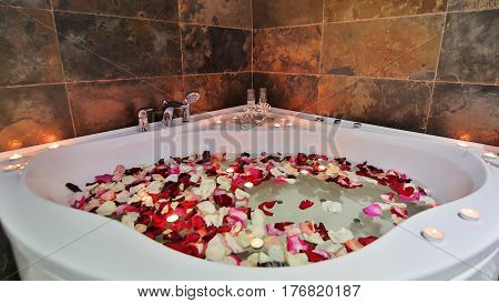 jacuzzi in luxury health spa with candels