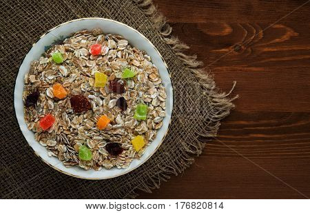 Muesli  With  Dried Fruit (strawberries, Grapes, Kiwi, Peach). Muesli On A Wooden Table. Muesli Top