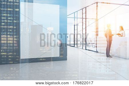 Side view of a businessman standing near a reception desk and talking to the receptionist. There is a poster on the wall. Toned image. Double exposure.