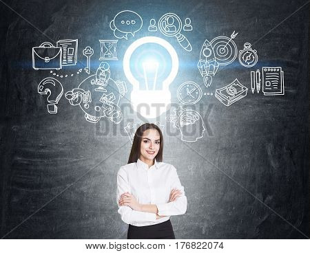Woman With Crossed Arms And Business Idea