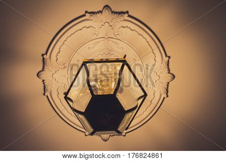 Antique glass lamp hanging on the ceiling