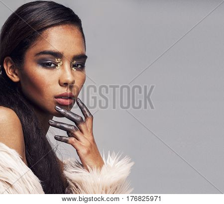 young beauty african american mulatto sensual woman with fashion make up, emotional face closeup copyspace
