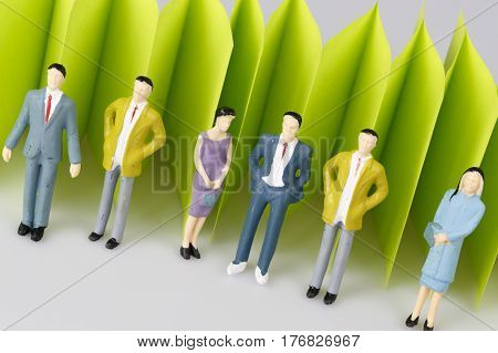 Abstract Green Paper Fence On White With Group Of Mature People