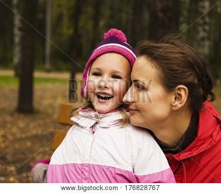 mature real mother with daughter outside in park, recreation concept, lifestyle people close up